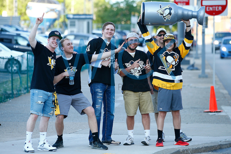 Pittsburgh Penguins fans pose for a photo with a replica Stanley Cup prior to game one of the Stanley Cup Final against the San Jose Sharks at Consol Energy Center in Pittsburgh, Pennslyvania on May 30, 2016. (Photo by Jared Wickerham / DKPS)