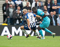 Tottenham Hotspur's Moussa Sissoko (right) battles for possession with Brighton & Hove Albion's Neal Maupay (left) <br /> <br /> Photographer David Horton/CameraSport<br /> <br /> The Premier League - Brighton and Hove Albion v Tottenham Hotspur - Saturday 5th October 2019 - The Amex Stadium - Brighton<br /> <br /> World Copyright © 2019 CameraSport. All rights reserved. 43 Linden Ave. Countesthorpe. Leicester. England. LE8 5PG - Tel: +44 (0) 116 277 4147 - admin@camerasport.com - www.camerasport.com