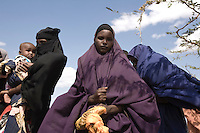 Kenya - Dadaab - A young Somali refugee who has just arrived in Dadaab from Kenya stands under the shade of a tree.