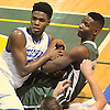 Cleevens Lans #5 of Kellenberg, left, and Derick Eugene #22 of Holy Trinity wrestle for possession during the NSCHSAA varsity boys basketball semifinals at LIU Post on Sunday, Feb. 28, 2016. Kellenberg won by a score of 55-49.