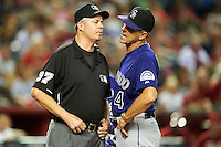 Colorado Rockies manager Jim Tracy #4 argues a call with umpire Gary Darling during a National League regular season game against the Arizona Diamondbacks at Chase Field on October 3, 2012 in Phoenix, Arizona. Colorado defeated Arizona 2-1. (Mike Janes/Four Seam Images)