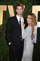 Liam Hemsworth and Miley Cyrus at the 2012 Vanity Fair Oscar Party hosted by Graydon Carter at Sunset Tower on February 26, 2012 in West Hollywood, California. © mpi23 / MediaPunch Inc.