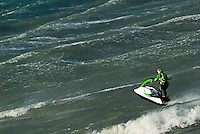 Man jumping on waves with jet-ski