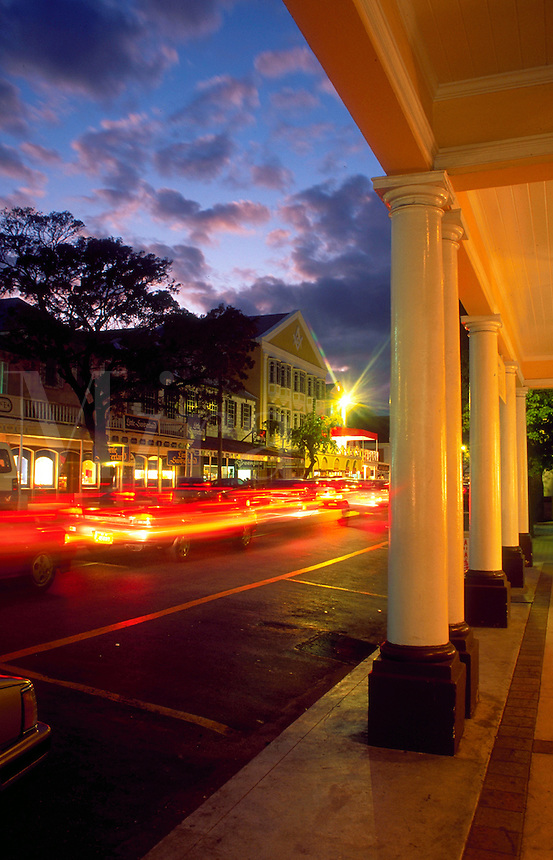 Shops and traffic along Bay Street at dusk. Nassau, Bahamas.