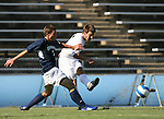 2 September 2007: Wake Forest's Cline Beam (r) passes the ball past Monmouth's Rich Baker (3). The Wake Forest University Demon Deacons defeated the Monmouth University Hawks 2-0 at Fetzer Field in Chapel Hill, North Carolina in an NCAA Division I Men's Soccer game.