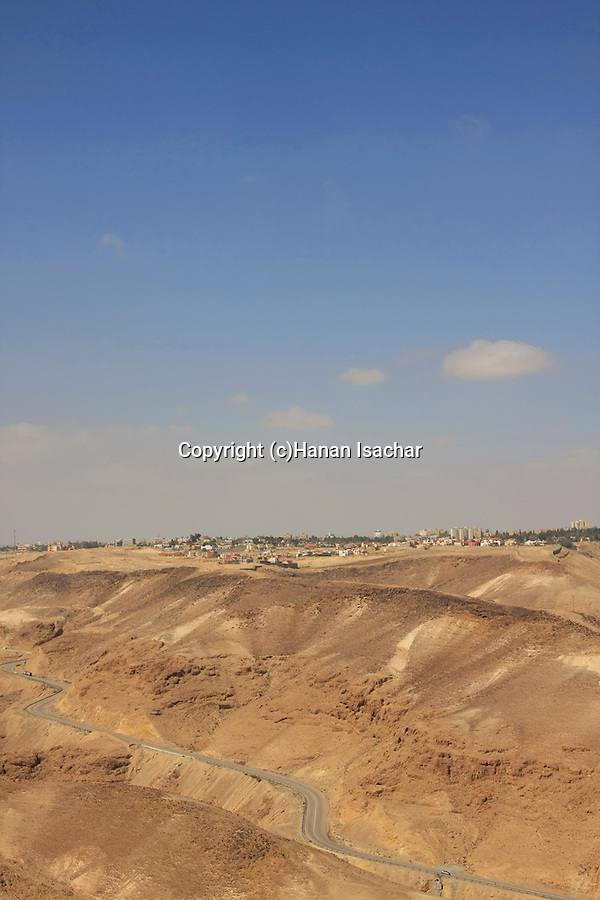 Israel, Judean Desert, a view from Rosh Zohar of Route 31, the Sodom-Arad road, Arad is in the background