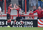 07/05/2016 Sky Bet League Two Morecambe v York City<br /> Andrew Fleming congratulates Moecambe's scorer Jamie Devitt