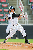 Collin Kuhn #20 of the Kannapolis Intimidators follows through on his swing against the Augusta GreenJackets at CMC-Northeast Stadium on May 2, 2012 in Kannapolis, North Carolina.  The GreenJackets defeated the Intimidators 9-6.  (Brian Westerholt/Four Seam Images)