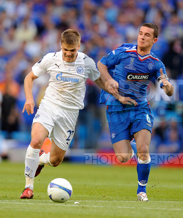 Igor Denisov of Zenit St Petersburg and Barry Ferguson of Rangers during the Europa League Final match at The Etihad Stadium, Manchester. Picture date 14th May 2008. Picture credit should read: Simon Bellis/Sportimage