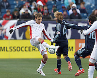 New England Revolution midfielder Scott Caldwell (6) intercepts Sporting Kansas City pass.  In a Major League Soccer (MLS) match, Sporting Kansas City (blue) tied the New England Revolution (white), 0-0, at Gillette Stadium on March 23, 2013.