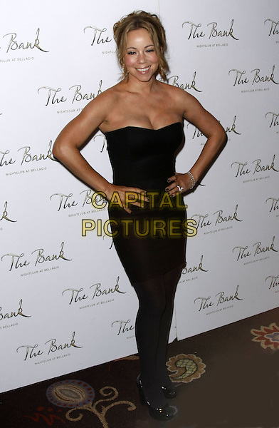 MARIAH CAREY.Mariah Carey Hosts at The Bank Nightclub inside the Bellagio Resort Hotel and Casino, Las Vegas, Nevada, USA..October 4th, 2008.full length black strapless dress hands on hips brown cleavage .CAP/ADM/MJT.© MJT/AdMedia/Capital Pictures.