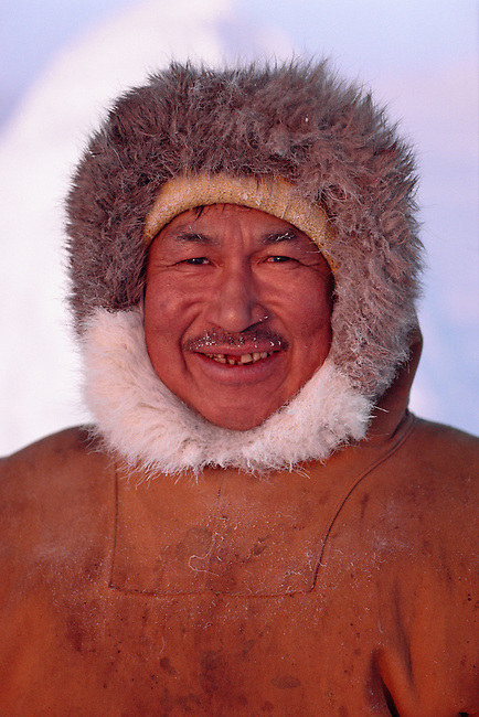 Inuit hunter, Avataq Henson wearing fur trimmed clothing Northwest Greenland.