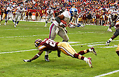Landover, MD - December 8, 2002 -- New York Giant running back Tiki Barber (21) eledes a tackle by Washington Redskins cornerback Champ Bailey (24) in second quarter action in Landover, Maryland.  The Giants won the game 27 - 21.<br /> Credit: Ron Sachs / CNP<br /> [NOTE: No New York Metro or other Newspapers within a 75 mile radius of New York City]