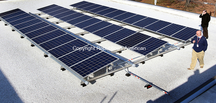 TORRINGTON CT. 24 November 2015-112415SV07-Officials tour the solar panels on the roof at Forbes School in Torrington Tuesday. The school was the first in the city to have solar panels installed on its roof and one on its wall to generate clean energy and reduce utility expenses. <br /> Steven Valenti Republican-American