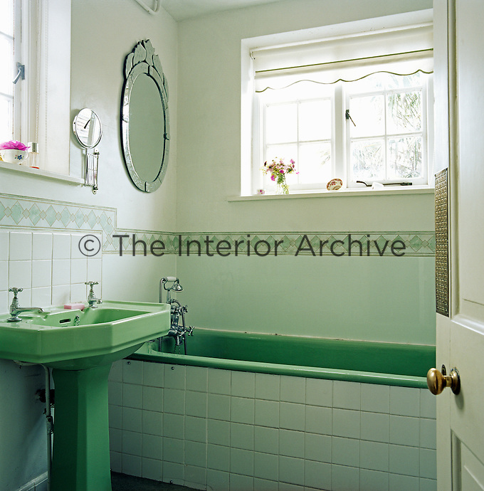 The bathroom features a 1960s green bath with a matching washstand