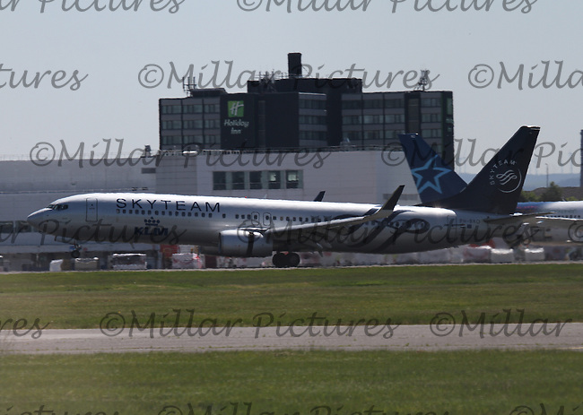 A KLM Royal Dutch Airlines Boeing 737-9K2 Registration PH-BXO in Skyteam livery at Glasgow Airport on 2.6.16 arriving from Amsterdam Schipol Airport.