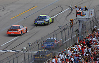 May 1, 2006; Talladega, AL, USA; Nascar Nextel Cup driver Jimmie Johnson of the (48) Lowes Chevrolet Monte Carlo crosses the finish line ahead of Tony Stewart (20) and Brian Vickers (25) to win the Aarons 499 at Talladega Superspeedway. Mandatory Credit: Mark J. Rebilas..