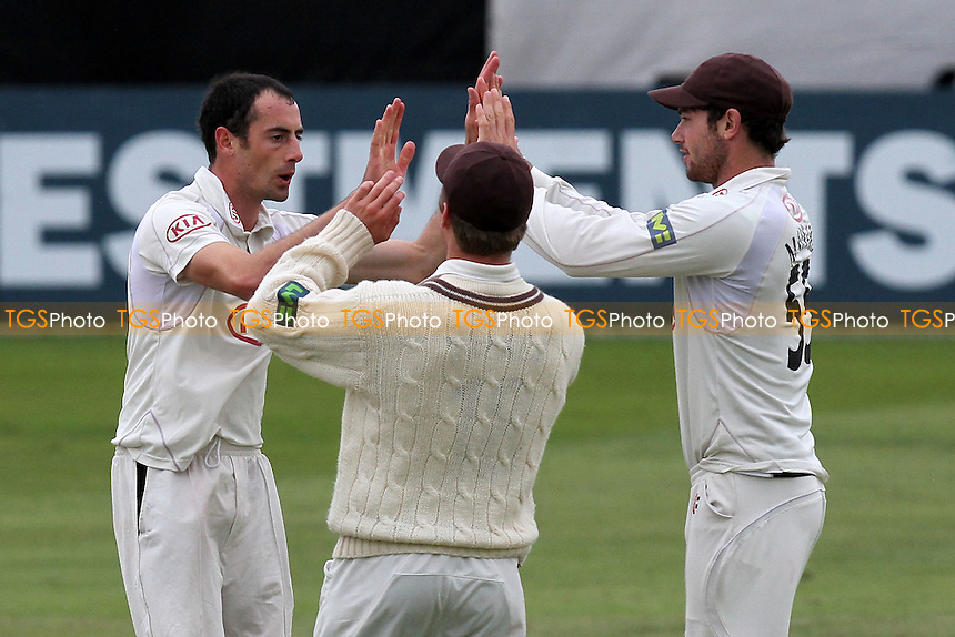 Tim Linley of Surrey is congratulated on the wicket of Tom Westley - Essex CCC vs Surrey CCC - LV County Championship Division Two Cricket at The Ford County Ground, Chelmsford, Essex - 08/09/11 - MANDATORY CREDIT: Gavin Ellis/TGSPHOTO - Self billing applies where appropriate - 0845 094 6026 - contact@tgsphoto.co.uk - NO UNPAID USE