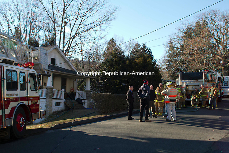 THOMASTON, CT, 30 December 2014-123014LW01- Firefighters respond to a fire in Thomaston that displaced eight people on Tuesday. Laraine Weschler Republican-American