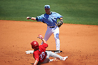 Charlotte Stone Crabs second baseman Jace Conrad (19) throws to first as Allen Staton (33) slides into second during a game against the Palm Beach Cardinals on April 10, 2016 at Charlotte Sports Park in Port Charlotte, Florida.  Palm Beach defeated Charlotte 4-1.  (Mike Janes/Four Seam Images)