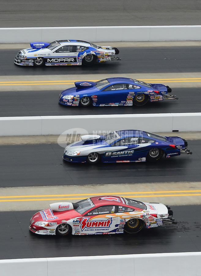 Apr. 15, 2012; Concord, NC, USA: NHRA pro stock drivers (from top) Allen Johnson, Kurt Johnson, Mark Martino and Greg Anderson race during the first round of eliminations for the Four Wide Nationals at zMax Dragway. Mandatory Credit: Mark J. Rebilas-