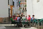 Group of people at cafe outside table Montejaque, Serrania de Ronda, Malaga province, Spain