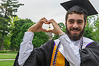 May 17, 2015; Dan Courtney, graduate from the College of Engineering makes the shape of a heart in front of the Golden Dome shortly before the Commencement Ceremony. (Photo by Barbara Johnston/University of Notre Dame)