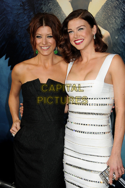 "KATE WALSH & ADRIANNE PALICKI .""Legion"" Los Angeles Premiere held at Arclight Cinemas Cinerama Dome,  Hollywood, California, USA, .21st January 2010..half length black dress strapless white green dangly earrings striped silver jewelled beaded crystals hand on hip clutch bag cleavage bodycon bandage CAP/ADM/BP.©Byron Purvis/AdMedia/Capital Pictures."