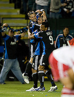 Scott Sealy of Earthquakes and Bobby Convey of Earthquakes celebrates with Bobby Burling of Earthquakes after Burling scored a goal during the second half of the game against Red Bull at Buck Shaw Stadium in Santa Clara, California.  San Jose Earthquakes defeated New York Red Bulls, 4-0.