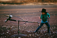 Young cow poke lassos a wooden steer with his rope on the Dixie Valley Ranch in a remote part of Lassen County.