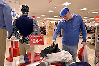STAFF PHOTO BEN GOFF  @NWABenGoff -- 12/26/14 Tommy Hyde of Lowell looks at sweaters while shopping after-Christmas sales at the JCPenney at Pinnacle Hills Promenade in Rogers on Friday Dec. 26, 2014.