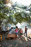 MEXICO, San Pancho, San Francisco, La Patrona Polo Club, families barbeque and prepare food for after the match