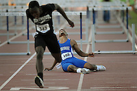 Kelly.Jordan@jacksonville.com--050512--Alonzo Square, of First Coast High School, (193), just misses the last hurdle causing him to tumble to the ground as he competes in the Boys 110 Meter Hurdles Final during the FHSAA Class 4A Track and Field Finals at the University of North Florida in Jacksonville, Florida Saturday May 5, 2012.(The Florida Times-Union, Kelly Jordan)