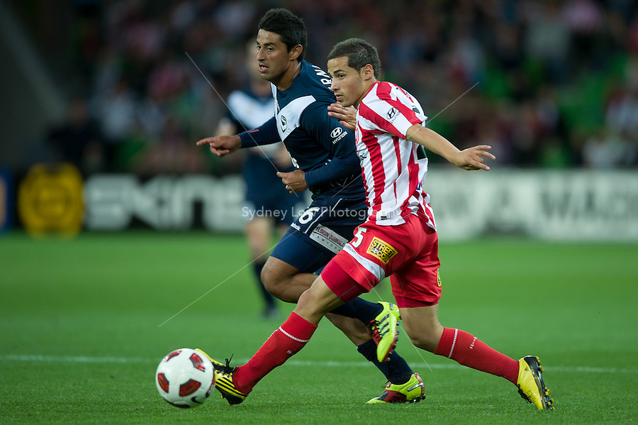 MELBOURNE, AUSTRALIA - DECEMBER 11: Adrian Zahra of the Heart and Carlos Hernandez of the Victory compete for the ball during the round 18 A-League match between the Melbourne Heart and Melbourne Victory at AAMI Park on December 11, 2010 in Melbourne, Australia. (Photo by Sydney Low / Asterisk Images)