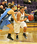SIOUX FALLS, SD - DECEMBER 5:  Taylor Varsho #3 from the University of Sioux Falls drives against Emily Gustafson #11 from Upper Iowa in the second half of their game Friday night at the Stewart Center.  (Photo by Dave Eggen/inertia)