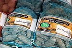 Bags of Scottish salad Pink Fir Apple  seed potatoes on sale Ladybird Nurseries garden centre, Gromford, Suffolk, England, UK