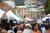Crowds fill the Salamanca Market.  The popular weekly market, held in Salamanca Place, draws locals and tourists with its food and craft stalls.  Hobart, Tasmania, AUSTRALIA