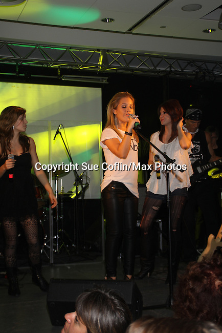 """One Life To Girls sing at the 9th Annual Rock Show for Charity to benefit the American Red Cross of Greater New York on October 9, 2010 at the American Red Cross Headquarters, New York City, New York. Also singing were Kristen Alderson (We Belong) followed by Kelley Missal, Kristen Alderson and Brittany Underwood (I Love Rock N'Roll), Brittany Underwood """"Life Is A Highway"""", Kim Zimmer """"If You Don't Know Me By Now"""" and """"Simply The Best"""", David Gregory """"I'm Gonna Be"""", Jason Tam """"Power of Love"""" and """"Jessie's Girl"""", Sandra Santiago """"Landslide"""" and """"Gloria"""". For Guiding Light - Bradley Cole """"I Ran"""", """"White Wedding"""" and ending with """"Pride and Joy"""", Karla Mosley """"I Wanna Dance"""" and """"Ben"""". Items were auctioned off and many dollars were raised. (Photos by Sue Coflin/Max Photos)"""