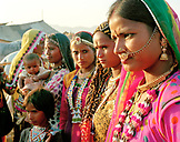 INDIA, Rajasthan, close-up of women of Punjab in traditional clothes at the Pushkar Camel Fair
