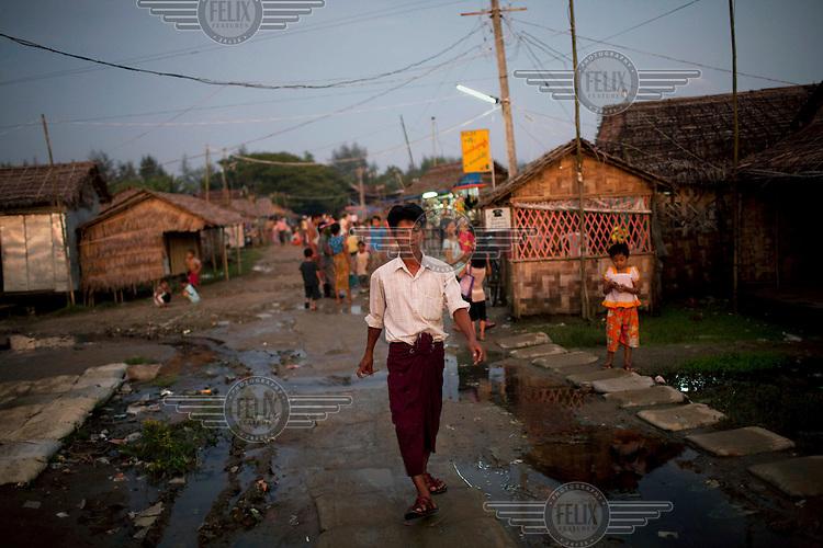 A man walks through the Hlaing Thaya slum district of Yangon.