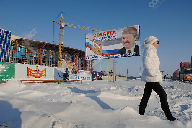 A girl walked past a new sports centre being built with Gazprom funds in the city of Novy Urengoy, the base of operations for Gazprom's Yuzhno-Russkoye natural gas field in the Yamal-Nenets Autonomous District, Russia, February 29, 2008