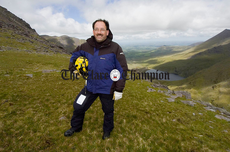 Winch operator John Manning stands on the mountains just under Carrauntohill in Kerry. Photograph by John Kelly.