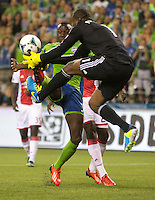 Jhon Kennedy Hurtado, left, of the Seattle Sounders FC collides with Donovan Ricketts of the Portland Timbers during play at CenturyLink Field in Seattle Saturday August, 3, 2013. The Sounder won the match 1-0.