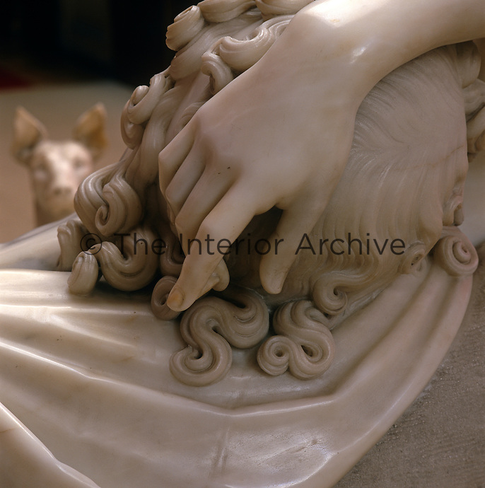 The delicately carved, smooth marble hand of Endymion is elegantly draped over his head of curls in Canova's 'Sleeping Endymion', 1819-1822