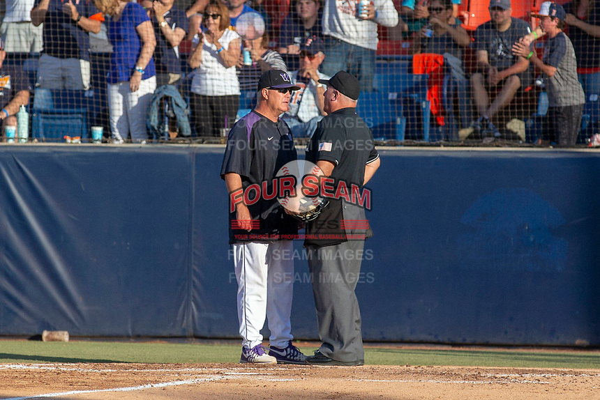 University of Washington Huskies head coach Lindsay Meggs confers with home plate umpire Tony Walsh during the game against the Cal State Fullerton Titans at Goodwin Field on June 10, 2018 in Fullerton, California. The Huskies defeated the Titans 6-5. (Donn Parris/Four Seam Images)