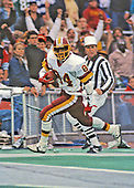 Washington Redskins wide receiver Gary Clark (84) scores a touchdown after catching a 47 yard pass from quarterback Jay Schroeder in the fourth quarter of the game against the Philadelphia Eagles at Veterans Stadium in Philadelphia, Pennsylvania on November 8, 1987.  The Eagles won the game 31 - 27.<br /> Credit: Arnie Sachs / CNP