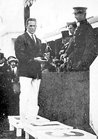 August-September 1920, Olympic Stadium, Antwerp, Belgium;  1920 Summer Olympic Games;   Norman Ross receiving his first prize for the 400 and 1500 meters races Olympic Games 1920 ; A total of 29 nations participated in the Antwerp Games, only one more than in 1912, as Germany, Austria, Hungary, Bulgaria and Ottoman Empire were not invited, having lost World War I.