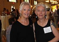NWA Democrat-Gazette/CARIN SCHOPPMEYER Arbor, CASA training specialist (left) and Rebecca Buchanan attend the Celebration of Success.