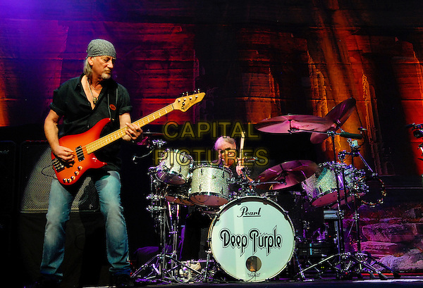 Roger Glover and Ian Paice.British rock band Deep Purple perform on stage at Hamilton Place Theatre, Hamilton, Ontario, Canada, .13th February 2012..music on stage live concert gig full length playing guitar bass drummer drums .CAP/ADM/BPC.©Brent Perniac/AdMedia/Capital Pictures.