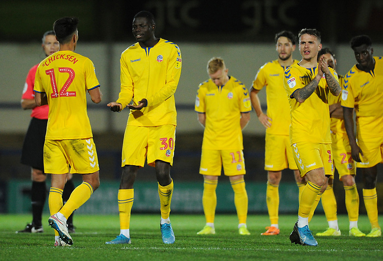 Bolton Wanderers' Adam Chicksen is consoled by team-mate Yoan Zouma after missing a penalty<br /> <br /> Photographer Kevin Barnes/CameraSport<br /> <br /> EFL Leasing.com Trophy - Northern Section - Group F - Rochdale v Bolton Wanderers - Tuesday 1st October 2019  - University of Bolton Stadium - Bolton<br />  <br /> World Copyright © 2018 CameraSport. All rights reserved. 43 Linden Ave. Countesthorpe. Leicester. England. LE8 5PG - Tel: +44 (0) 116 277 4147 - admin@camerasport.com - www.camerasport.com